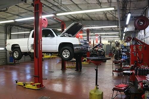 RT Clapp Garage - techs working under the hood